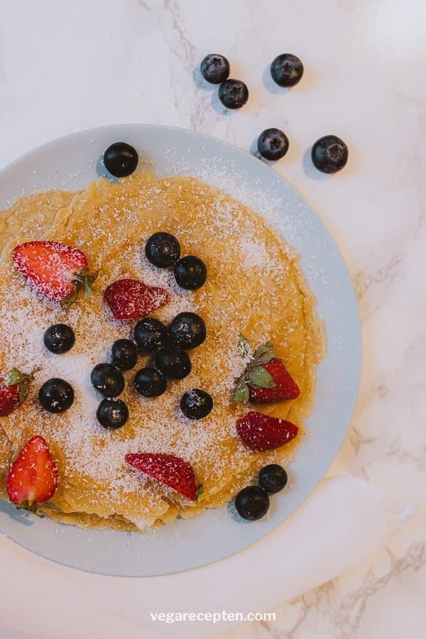 Vegan pancakes with red fruit and coconut